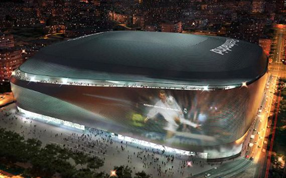 The New Santiago Bernebeu at night they will even beam images onto the chrome outside.