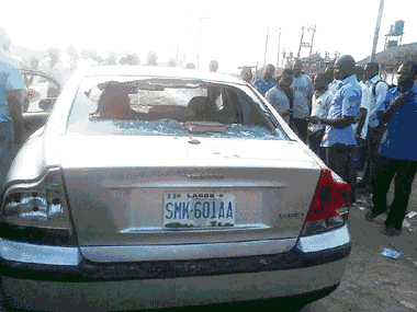 one of the cars damaged in the protest