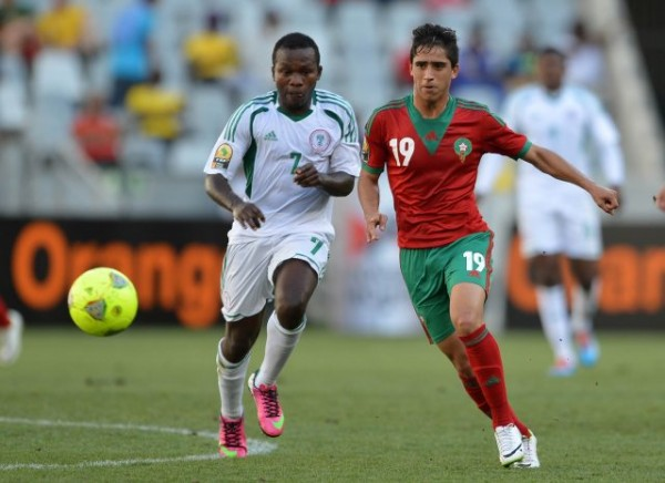 Rangers' Chrisantus Ejike Tackles Abdelkbir el Ouadi of Morocco in CHAN Quarter-Final.