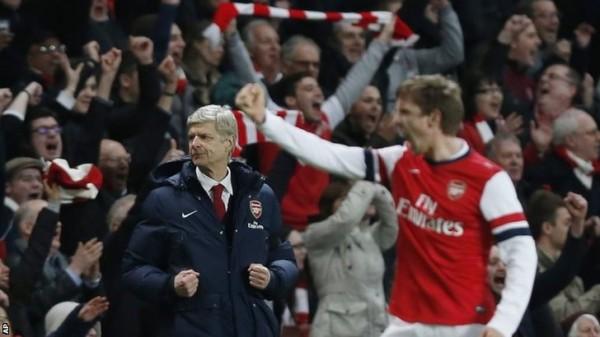 Wenger Celebrates Lukas Podolski's Goal in Arsenal's Win Over Liverpool. Image: PA.