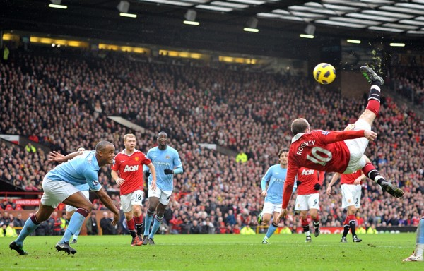 Wayne Rooney scores his United's second goal against Man City with an overhead kick in a league game.