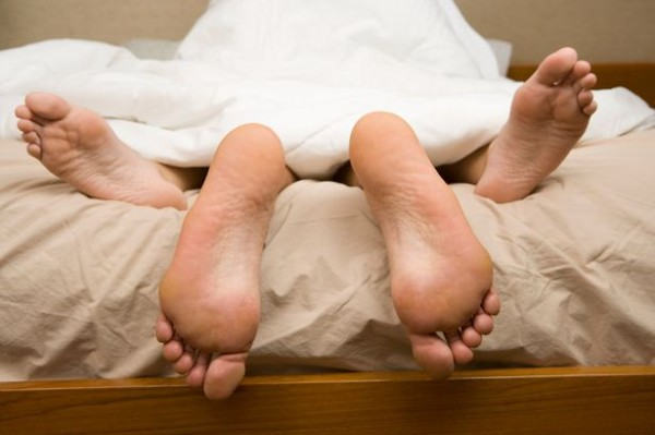 View-of-feet-of-couple-having-sex-in-bed-1384637-600x399