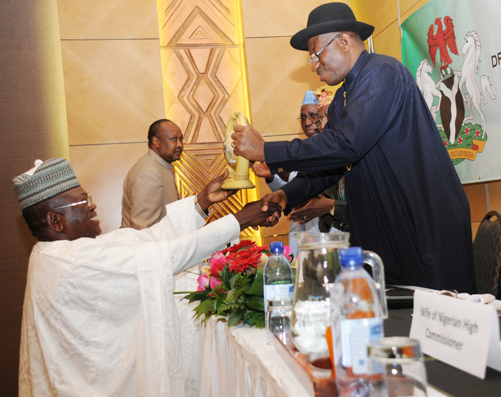 PRESIDENT GOODLUCK JONATHAN RECEIVING A SOUVENIR FROM THE PRESIDENT, NIGERIAN COMMUNITY IN NAMIBIA, MR BUBA MADUGU, AT A MEETING OF PRESIDENTJONATHAN WITH NIGERIANS IN NAMIBIA ON THURSDAY (NAN)