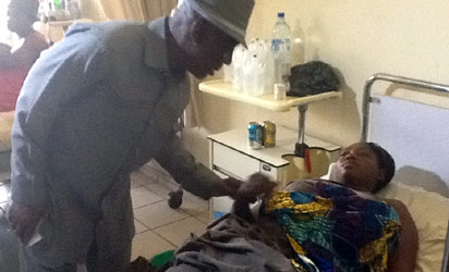 MINISTER OF THE INTERIOR, ABBA MORO WITH ONE OF THE INJURED VICTIMS AT THE NATIONAL HOSPITAL, ABUJA
