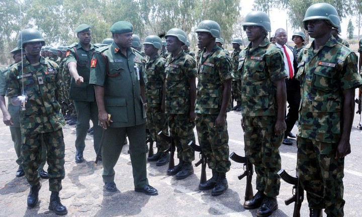 CHIEF OF ARMY STAFF, LT.- GEN.  KENNETH MINIMAH, INSPECTING A PARADE, DURING A PARADE  IN HIS HONOUR,  AT INFANTRY CORPS IN JAJI, KADUNA, ON FRIDAY (21/3/14).