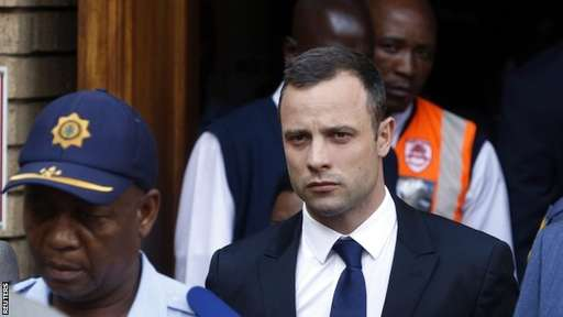 Oscar Pistorius Trial Day Four: The Paralympic Star Being Escorted Outside the Pretoria Court By Guards.