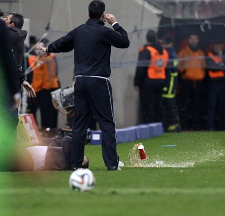 Panathinaikos Manager Anastasiou Hit With an Object Thrown from the Crowd During His Side's 3-0 Win Over Olympiakos.