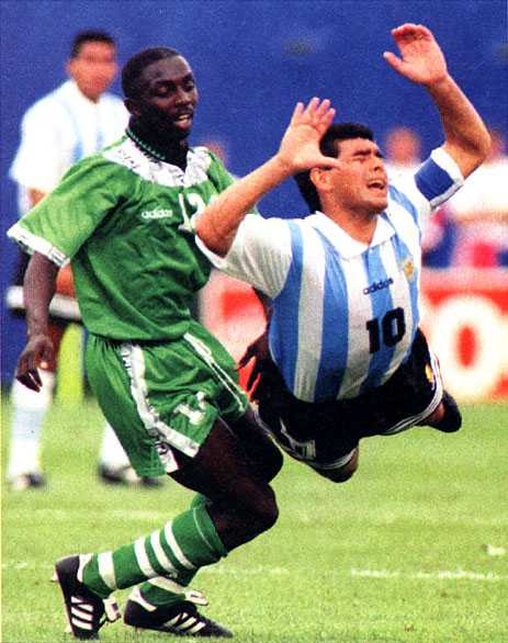 Samson Siasia, Scorer of Nigeria's Solitary Goal in the 2-1 Loss Against Argentina in 94, Tackles Diego Maradona, Before the Latter's Untimely Exit from World Football Due to Drug Claims.