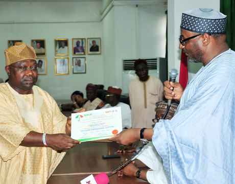 PDP NATIONAL CHAIRMAN, ALHAJI ADAMU MU'AZU (R), PRESENTING PDP CERTIFICATE OF RETURN TO THE WINNER OF PDP OSUN GOVERNORSHIP PRIMARY, SEN. IYIOLA OMISORE IN ABUJA ON THURSDAY (10/4/14).
