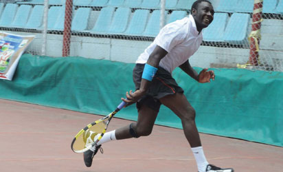 Nigerian Tennis Player in Action During the CBN Tennis Championship.