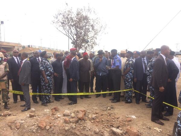 PRESIDENT JONATHAN & HIS ENTOURAGE BEING BRIEFED AT THE SITE OF THE CRATER LEFT BEHIND BY THE EXPLOSION IN NYANYA ON MONDAY