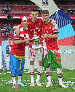Arsenal players celebrate after a nine-years trophy draught