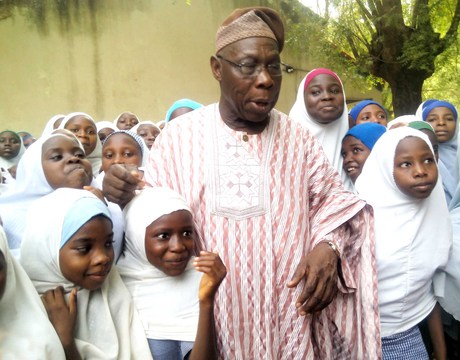 FORMER PRESIDENT OLUSEGUN OBASANJO WITH PUPILS AND STUDENTS OF HIS ADOPTED SCHOOL,  GOVERNMENT GIRLS SECONDARY SCHOOL, KUDAI IN JIGAWA ON MONDAY (12/5/14).
