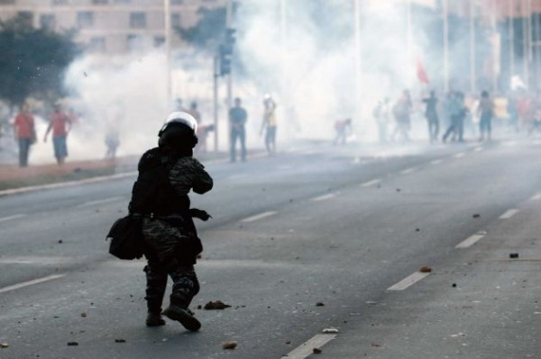 A Military Police Officer Fires Teargas at Protesters in Brasilia on Tuesday.