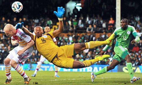 Ejide In Action Against Scotland at Craven Cottage.