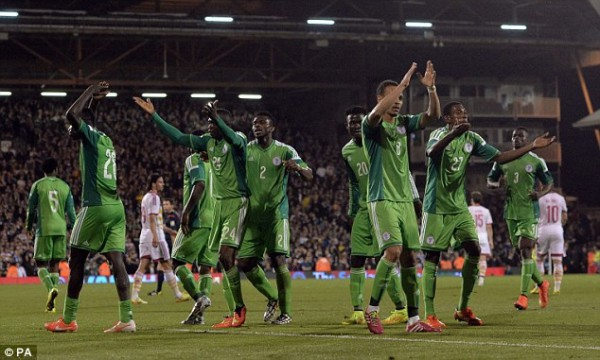 Nigerian Players Celebrates Uche Nwofor's 91st Minute Leveler.PA.