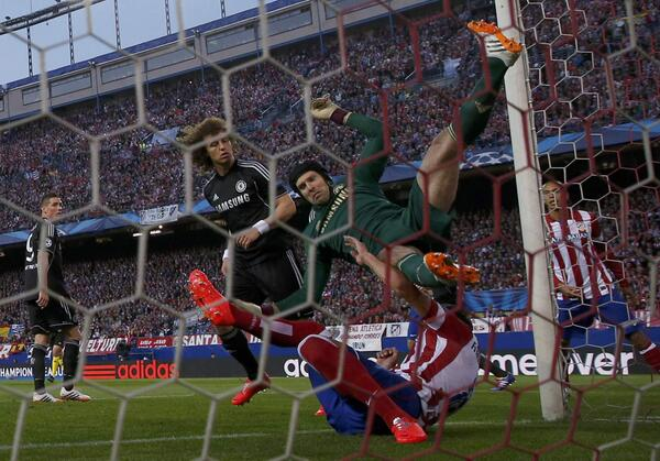Petr Cech Collides With Atletico's Raul Garcia During Their Champions League Semi-Final First Leg.