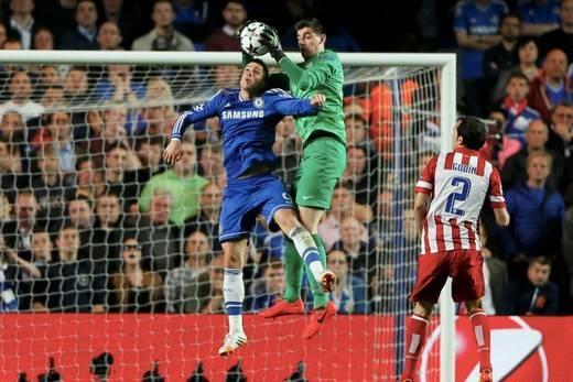 Thibault Courtois Saves the Ball Off a Fernando Torres Challenge.