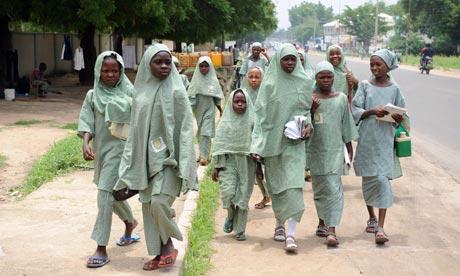 MDG : Nigeria : School girls walk home School girls walk home in Maiduguri , Borno