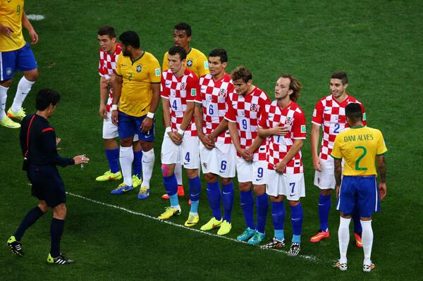 Japanese Referee, Nishimura , Mapping Out the Free Kick Line With His Spray Can During Brazil vs. Croatia World Cup Opener.