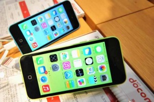 French-Catholic-priest-offering-blessings-for-parishioners-smartphones