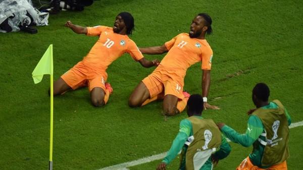 Gervinho and Drogba Celebrates Ivory Coast's Winning-Goal Against Japan.