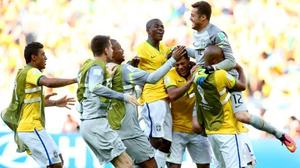 Julio Cesar Being Celebrated By His Team-Mates After Helping Selecao Advance in World Cup.