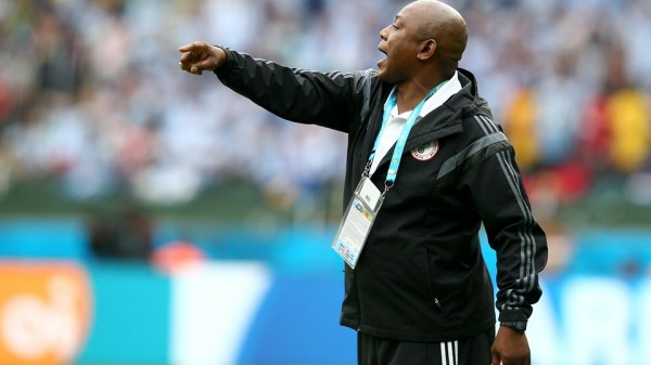 Stephen Keshi Passes Instructions to His Wards During the 3-2 Loss to Argentina.