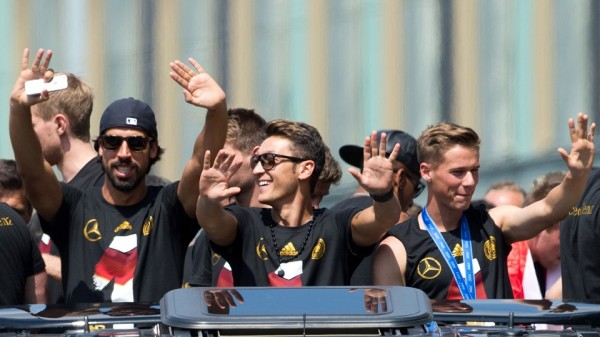 Mesut Ozil, Sami Khedira and Co On the Open-Top Bus in Berlin. Image: AFP.