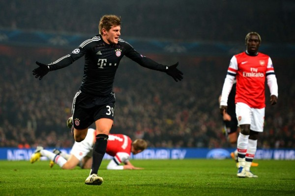 Toni Kroos Celebrates Scoring Against Arsenal in the Champions League.