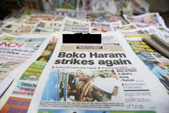 A newspaper with its headline on an abduction of women is displayed in Lagos