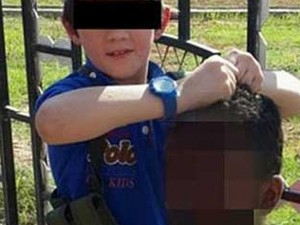7-Year-Old Boy Poses With Severed Head In Syria