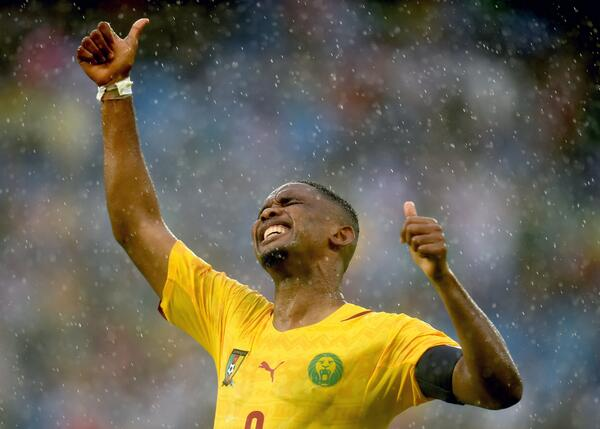 Samuel Eto'O Reacts After Missing a Goal-Scoring Opportunity in a 2014 World Cup Game Against Mexico.