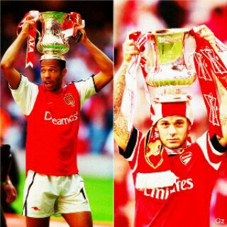 Thierry Henry and Jack Wilshere with the Fa cup trophy