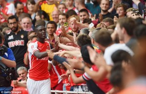 Sanogo celebrates with the fans