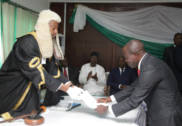 GOV. ADAMS OSHIOMHOLE PRESENTING THE BUDGET ESTIMATES FOR 2015 FISCAL YEAR TO THE SPEAKER, UYI IGBE LAST WEEK