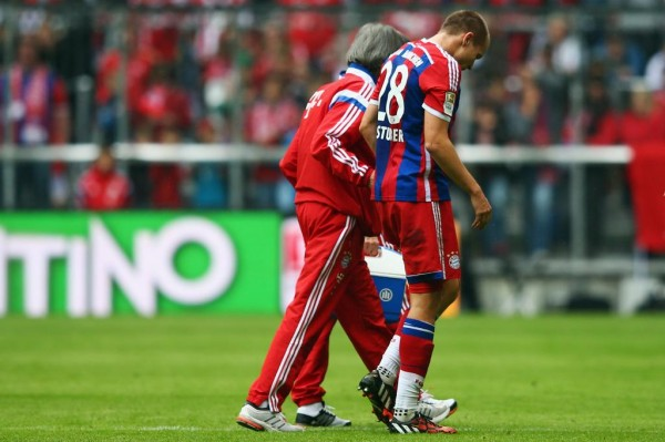 Holger Badstuber Been Assisted Off the Pitch By Bayern Medics During Sunday's Win Over Stuttgart. Image: Getty.