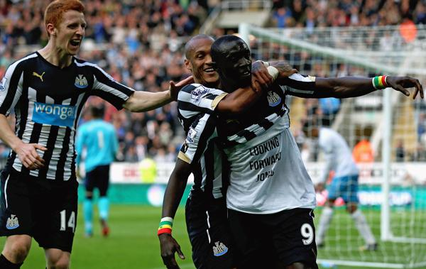 Papiss Cisse Cisse Celebrates His Goal Lifting His Shirt to Reveal a Message in Support of the Ailing Jonas Gutierrez. Image: Getty.