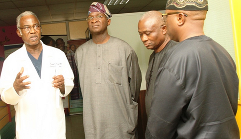 LAGOS STATE GOVERNOR, MR. BABATUNDE FASHOLA, SAN, BEING CONDUCTED ROUND BY THE CHIEF EXECUTIVE OFFICER/CHIEF MEDICAL DIRECTOR, FIRST CONSULTANTS HOSPITAL OBALENDE, DR BENJAMIN OHIAERI DURING HIS VISIT TO THE HOSPITAL