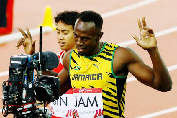 Usain Bolt After Running the  Commonwealth 4by100m Relay Heat. Image: AFP.