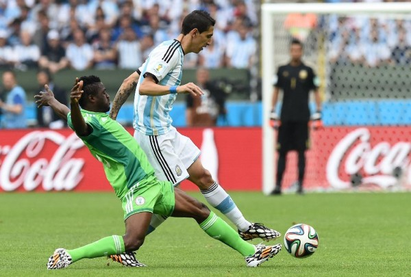Babtunde Michael Tackles Manchester United's Angel Di Maria in a Group Game at the 2014 Fifa World Cup. Image: JEWEL SAMADJEWEL SAMAD/AFP/Getty.