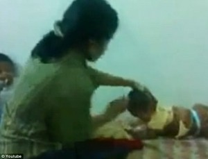 Malaysian mother Caught On Tape Beating Her 10-Month-Old Daughter