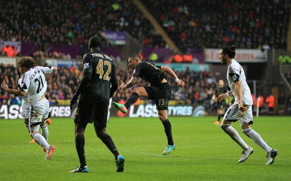 Aleksander Kolarov Scores a Beautifully Poked Shot Against Swansea. Image: Getty.