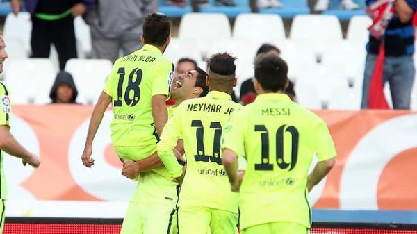 Luis Suarez Celebrates With Jordi Alba after Barca Winner. Image: Miguel Ruiz/ FC Barca